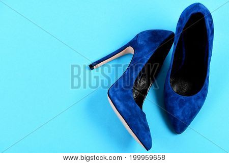Pair Of Blue Suede High Heel Shoes As Beauty Concept