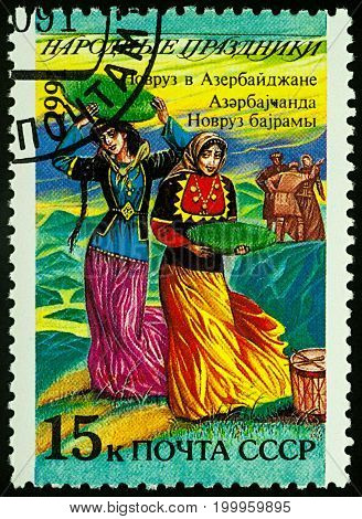 Moscow Russia - August 14 2017: A stamp printed in USSR shows Navruz holiday in Azerbaijan series