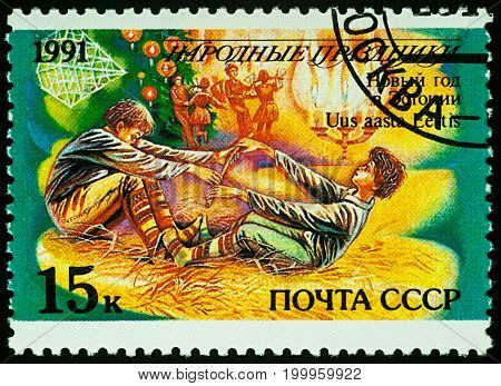 Moscow Russia - August 14 2017: A stamp printed in USSR shows New Year in Estonia series