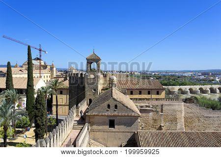 Stone Walls And Towers Of The Alcazar De Los Reyes Cristianos In Cordoba