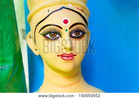 KOLKATA WEST BENGAL INDIA - 25 SEPTEMBER 2016: Clay idol of Goddess Durga's face under preparation for