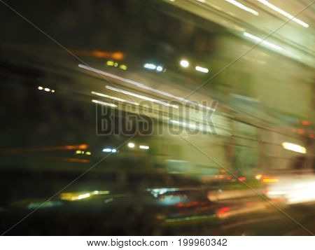 The line of bright light from the car with abstract background.