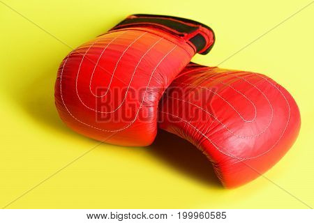 Healthy Lifestyle And Sports Equipment Concept With Red Boxing Mittens
