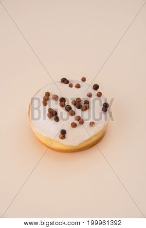 Shot of delicious donut with white cream and flakes isolated over white