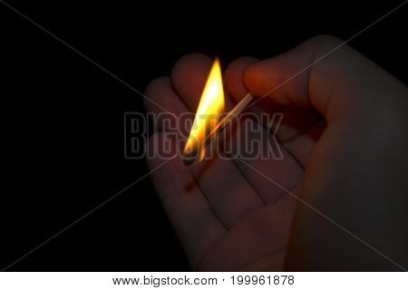 Hot in the darkness of the match in the hand