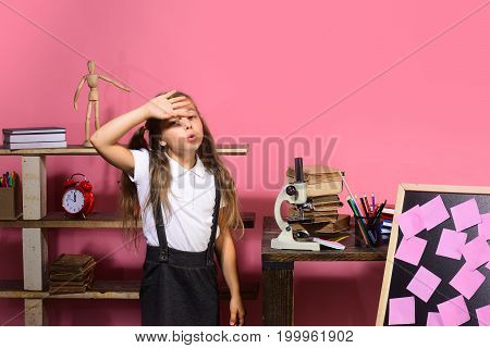 Kid And School Supplies On Pink Background
