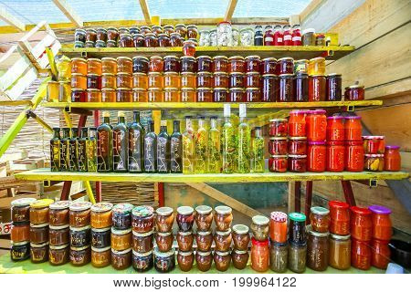 Opuzen, Croatia - 16th July, 2017 : Homemade food products olive oil honey of several plants lavender rosemary pomegranate and jam of several types of fruit figs and mandarin and chutney displayed at a food stand in Opuzen, Croatia.