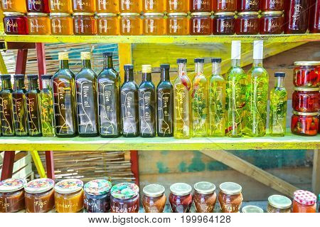 Opuzen, Croatia - 16th July, 2017 : Homemade food products olive oil honey of several plants lavender rosemary pomegranate and jam of several types of fruit figs and mandarin displayed at a food stand in Opuzen, Croatia.