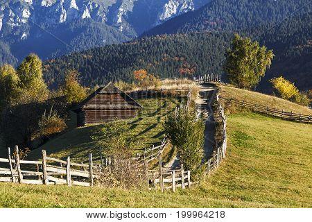 Autumn rustic landscape with barn in Carpathian mountains, Transylvania, Romania