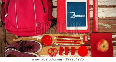 Back to school text on white background against overhead view of bag and digital tablet on table