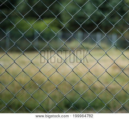 Wire fence in focus with a bokeh backdrop