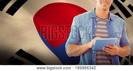 Student using tablet against korea republic flag waving