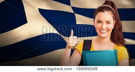Student with thumbs up against digitally generated greek national flag