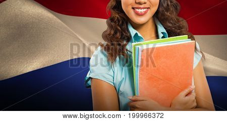Happy student against digitally generated dutch national flag