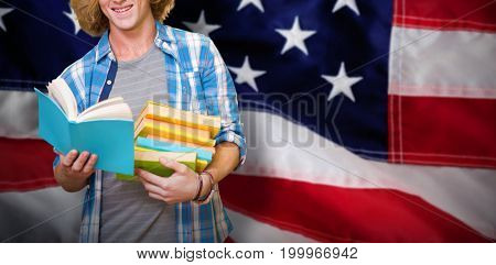Student reading book against close-up of red and white american flag