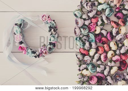 Beautiful hair wreath with flowers flat lay. Stylish handmade accessories, female decoration, beauty concept