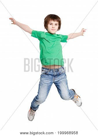 Jumping happy boy on white isolated background. Casual kid bouncing with raised hands at studio. Active life and happy childhood concept