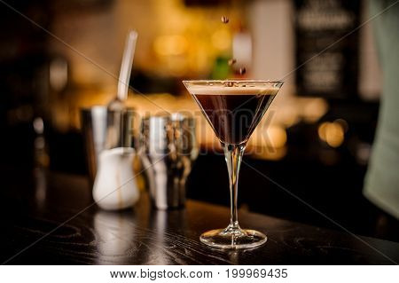 classy bartender garnish martini espresso cocktail drink foam coffee bean on top bar counter