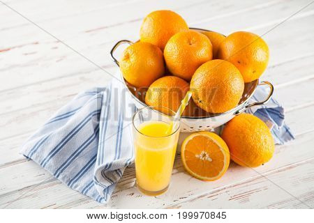 Fresh oranges in a colander