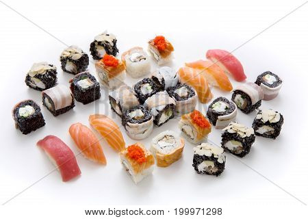 Japanese food restaurant delivery - black rice seafood rolls, tuna and salmon nigiri in big part set isolated on white background