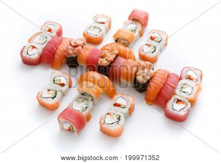 Japanese food restaurant delivery - tuna sushi maki, salmon rolls and spicy gunkans big party platter set isolated on white background