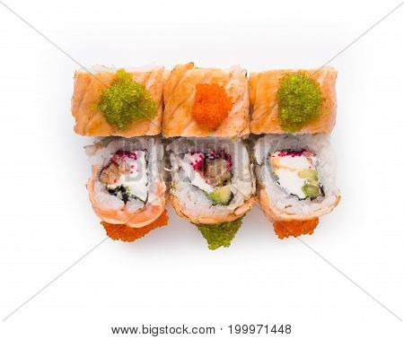 Healthy japanese restaurant food delivery. Set of salmon rolls with soft cheese and colored caviar isolated, closeup. Top view on colorful sushi