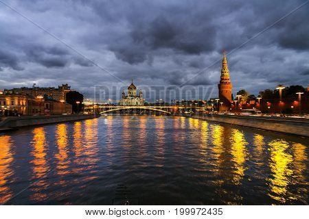 Moscow, Russia. Aerial view of popular landmark Kremlin in Moscow, Russia at night. Illuminated Kremlin wall from touristic boat at Moscow river.