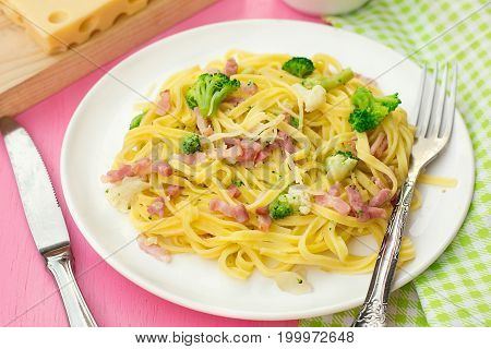 Fresh pasta linguine with bacon broccoli and cauliflower
