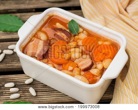 Haricot bean stew with smoked pork and carrots