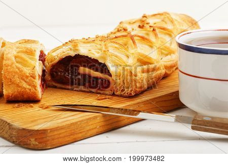 Closeup Homemade Cherry Strudel On A White Wooden Table