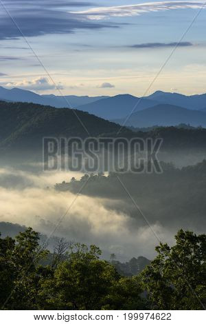 Foggy Morning View of Mountains in Summer