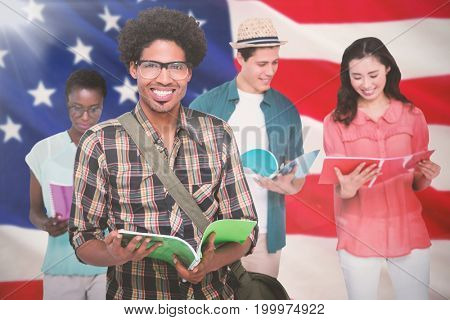 Stylish students smiling at camera together against close-up of us flag