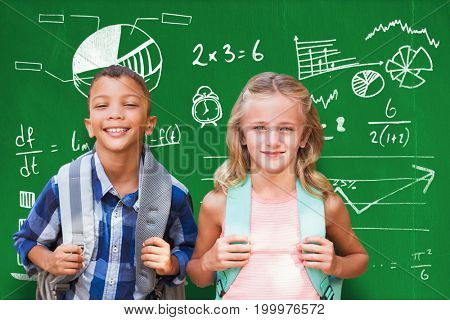 Portrait of students with backpacks against blackboard with copy space on wooden board