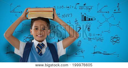 Smiling schoolboy carrying books on head over white background against blue background