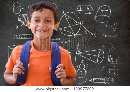 Portrait of smiling boy  against close-up of blackboard