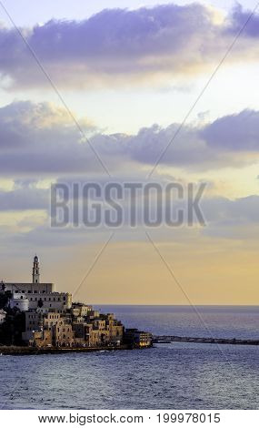 Jaffa port promenade at sunset with saint Peter church