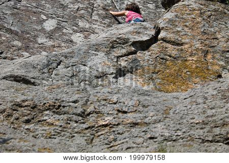 Girl Rock Climber Climbs On A Rock