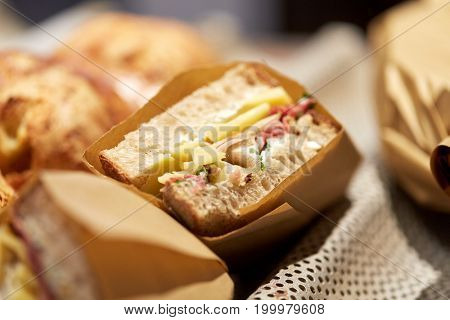 food, cooking and sale concept - craft sandwich at grocery store
