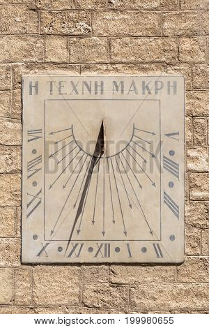 Old sundial in a stone facade Montpellier France