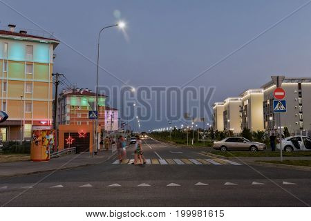 SOCHI RUSSIA - AUGUST 09: Evening light on the sidewalks and illumination of buildings in the hotel complex Velvet Seasons . August 09 2017 in Sochi Russia.