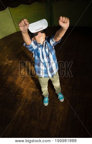 Boy using virtual reality headset at home