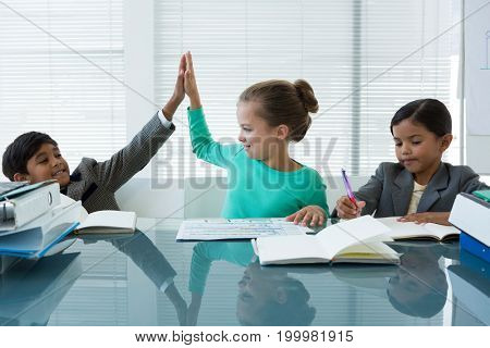 Business people working in boardroom at office