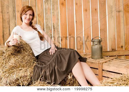 Young Healthy Woman Hold Glass Of Milk In Barn