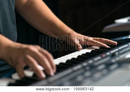 A Musician Plays The Keyboard Musical Instrument, Close-up
