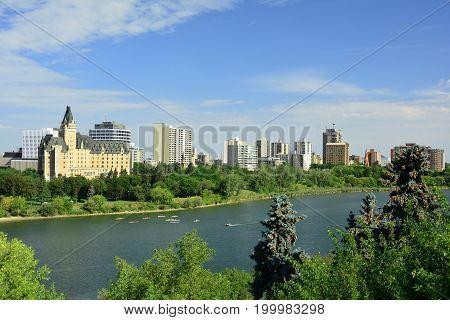 Saskatoon Saskatchewan,August 11th 2017.The skyline of Saskatoon with the South Saskatchewan river that runs through it and the University bridge in the distance.Come enjoy the river activities.