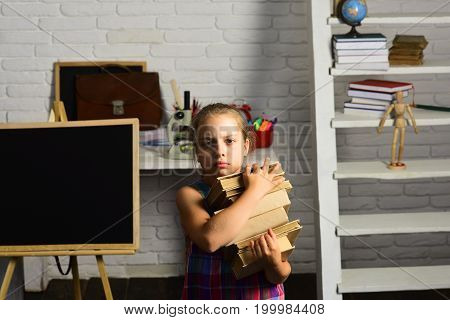 Girl With Tired Face In Front Of School Supplies