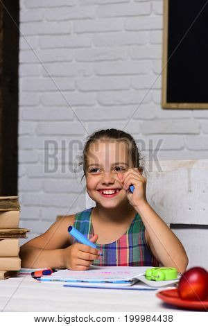 Girl Sits At Desk With Fruit And Books