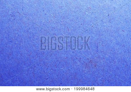 Background paper cardboard. Purple fibers. Blue texture.