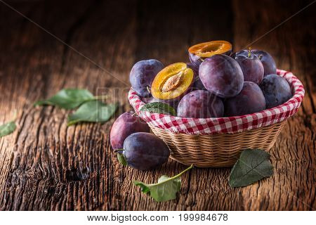 Plums. Fresh Juicy Plums In A Bowl On A Wooden Or Concrete Board