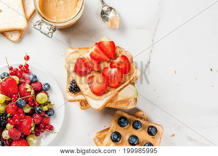 Sandwiches With Peanut Butter, Berry And Fruit